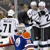 Los Angeles Kings\' Jordan Nolan, 71, Colin Fraser, 24, and Trevor Lewis, 22, celebrate Fraser\'s goal on the Edmonton Oilers during second period NHL hockey action in Edmonton, Alberta, on Tuesday Feb. 19, 2013. (AP Photo/THE CANADIAN PRESS,Jason Franson)
