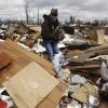 Christa Suchowski search through a home destroyed by a tornado in Marysville, Ind., Sunday, March 4, 2012. Calm weather gave dazed residents of storm-wracked towns a respite on Sunday as they dug out from a chain of tornadoes that cut a swath of destruction from the Midwest to the Gulf of Mexico, killing at least 39 people. (AP Photo/Nam Y. Huh) ORG XMIT: INNH104