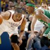 Oklahoma City\'s Russell Westbrook (0) grabs a loose ball in front of Boston\'s Paul Pierce during the NBA game between the Oklahoma City Thunder and the Boston Celtics, Sunday, Nov. 7, 2010, at the Oklahoma City Arena. Photo by Sarah Phipps, The Oklahoman
