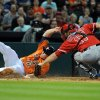 Photo - Houston Astros' Marc Krauss, left, is tagged out at home by Los Angeles Angels' Chris Iannetta in the second inning of a baseball game on Friday, April 4, 2014, at Minute Maid Park in Houston. (AP Photo/Eric Christian Smith)
