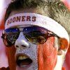 An Oklahoma fan cheers on his team during the first half of the Bedlam college football game between the University of Oklahoma Sooners (OU) and the Oklahoma State University Cowboys (OSU) at the Gaylord Family-Oklahoma Memorial Stadium on Saturday, Nov. 28, 2009, in Norman, Okla. Photo by Chris Landsberger, The Oklahoman