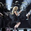 From left, Reid Perry, Kimberly Perry and Neil Perry, of musical group The Band Perry, perform at the 48th Annual Academy of Country Music Awards at the MGM Grand Garden Arena in Las Vegas on Sunday, April 7, 2013. (Photo by Chris Pizzello/Invision/AP) ORG XMIT: NVPM252