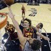 Photo - Cleveland Cavaliers' Anderson Varejao (17) shoots over San Antonio Spurs' Marco Belinelli (3), of Italy, during the first half of an NBA basketball game Saturday, Nov. 23, 2013, in San Antonio. (AP Photo/Eric Gay)