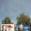 Photo -   A woman walks past a billboards showing presidential candidates: pro-Western former Serbian President Boris Tadic, reading: