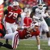 Photo -   Wisconsin quarterback Danny O'Brien stumbles during the second half of an NCAA college football game against Michigan State on Saturday, Oct. 27, 2012, in Madison, Wis. Michigan State won 16-13 in overtime. (AP Photo/Andy Manis)