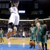 Oklahoma City\'s Serge Ibaka (9) hangs on the basket after a dunk as Boston\'s Jeff Green (8), Kelly Olynyk (41) and Gerald Wallace (45) look on during the NBA game between the Oklahoma City Thunder and the Boston Celtics at the Chesapeake Energy Arena., Sunday, Jan. 5, 2014. Photo by Sarah Phipps, The Oklahoman