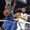 Oklahoma City\'s Russell Westbrook passes by Washington\'s Dominic McGuire during the NBA basketball game between the Oklahoma City Thunder and the Washington Wizards at the Ford Center in Oklahoma City, Wed., March 4, 2009. PHOTO BY BRYAN TERRY, THE OKLAHOMAN ORG XMIT: KOD