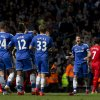 Photo - Chelsea's Frank Lampard, centre right, celebrates with teammates as his team beat Liverpool 2-0 in their English Premier League soccer match against Liverpool at Anfield Stadium, Liverpool, England, Sunday April 27, 2014. (AP Photo/Jon Super)
