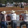 Three men watch bareback bronc event from behind a fence during the second go-round of the International Finals Youth Rodeo at the Heart of Oklahoma Exposition Arena in Shawnee, Okla., on Monday, July, 9, 2012. Tuesday, July 3, 2012. Photo by Jim Beckel, The Oklahoman