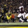Missouri running back Henry Josey, left, scores on a 57-yard run as Texas A&M defensive backs Deshazor Everett and De\'Vante Harris, right, give chase during the second half of an NCAA college football game on Saturday, Nov. 30, 2013, in Columbia, Mo. (AP Photo/Jeff Roberson)