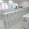 Photo - Indonesian electoral workers prepare ballot boxes to be distributed to polling stations in Jakarta, Indonesia, Tuesday, July 8, 2014. Indonesia elects a new president on Wednesday with two clear choices: On the one side is a wildly popular former furniture maker who is also Jakarta Governor Joko Widodo and on the other is an ex-army general with a dubious record and once the son-in-law of former dictator Suharto, Lt. Gen (ret.) Prabowo Subianto. (AP Photo/Tatan Syuflana)