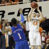 Oklahoma State \'s Phil Forte (13) shoots the ball over Kansas\' Naadir Tharpe (1) during the college basketball game between the Oklahoma State University Cowboys (OSU) and the University of Kanas Jayhawks (KU) at Gallagher-Iba Arena on Wednesday, Feb. 20, 2013, in Stillwater, Okla. Photo by Chris Landsberger, The Oklahoman