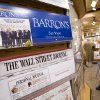 Photo -   This Monday, July 23, 2007, file photo shows advertising for on a New York newsstand. Facebook Inc.'s stock took a hit Monday, Sept. 24, 2012, after an article in Barron's said it is