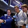 Photo - Czech Tomas Berdych, the 2014 U.S. Open tennis tournament sixth seed, center, and Fabrizio Sestini, ATP marketing director, right, visit with specialist Glenn Carell on the floor of the New York Stock Exchange, after Berdych rang the NYSE opening bell, Thursday, Aug. 21, 2014. (AP Photo/Richard Drew)