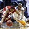 Photo - Tennessee Ariel Massengale, right, battles for the ball with Alabama's Jasmine Robinson in the first half of an NCAA college basketball game on Sunday, Jan. 20, 2013, in Knoxville, Tenn. (AP Photo/Wade Payne)