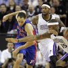 Detroit Pistons forward Tayshaun Prince, left, and Sacramento Kings DeMarcus Cousins scramble after the ball during the first half of an NBA basketball game in Sacramento, Calif., Wednesday, Nov. 7, 2012. (AP Photo/Rich Pedroncelli)