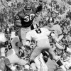 UNIVERSITY OF OKLAHOMA, COLLEGE FOOTBALL, OU SOONERS, 11/11/72. OU\'s Greg Pruitt picks up some of his 195 yards over the top of the Missouri defense. The Sooners defeated the Tigers 17-6. Staff photo by Roger Artman taken 11/11/72.