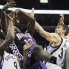 Sacramento Kings\' Tyreke Evans (13) looses the ball between Memphis Grizzlies\' Tony Allen (9), and Marc Gasol, right, during the first half of an NBA basketball game in Memphis, Tenn., Tuesday, Feb. 12, 2013. (AP Photo/Danny Johnston)