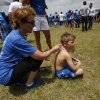 Debbie Pitman, of Oklahoma City, rubs ice on her grandson, Will Parker, 8, to cool him down during a welcome home rally for the Oklahoma City Thunder at a field near Will Rogers Airport in Oklahoma City, Friday, June 22, 2012. Photo by Garett Fisbeck, The Oklahoman