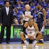Oklahoma City\'s Russell Westbrook (0) kneels down in front of Memphis head coach Lionel Hollins, left, official Joe Crawford and Mike Conley (11) of Memphis late in the second half during game one of the Western Conference semifinals between the Memphis Grizzlies and the Oklahoma City Thunder in the NBA basketball playoffs at Oklahoma City Arena in Oklahoma City, Sunday, May 1, 2011. Memphis won, 114-101. Photo by Nate Billings, The Oklahoman