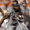 Oklahoma State\'s Jeremy Smith (31) rushes for a touchdown in the fourth quarter during a college football game between Oklahoma State University (OSU) and the West Virginia University at Boone Pickens Stadium in Stillwater, Okla., Saturday, Nov. 10, 2012. OSU won 55-34. Photo by Sarah Phipps, The Oklahoman
