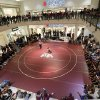 People watch wrestlers during the high school wrestling dual between Edmond Memorial and Putnam City at Quail Springs Mall in Oklahoma City, Tuesday,Jan. 15, 2013. Photo by Sarah Phipps, The Oklahoman