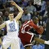 Oklahoma\'s Tony Crocker (5) pulls in a rebound over North Carolina\'s Tyler Hansbrough (50) during the second half in the Elite Eight game of NCAA Men\'s Basketball Regional between the University of North Carolina and the University of Oklahoma at the FedEx Forum on Sunday, March 29, 2009, in Memphis, Tenn. PHOTO BY CHRIS LANDSBERGER, THE OKLAHOMAN