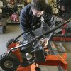 Photo - Kelly Pomerleau of Andover Small Engine Service repairs a snow blower for a customer in Andover, Mass., Thursday, Feb. 7, 2013, in preparation for a major winter storm headed toward the U.S. Northeast. The National Weather Service calls for up to 2 feet of snow expected for a Boston-area region that has seen mostly bare ground this winter. (AP Photo/Elise Amendola)