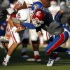 OU\'s Blake Bell (10) is tackled by KU\'s JaCorey Shepherd (24) in the fourth quarter during of the college football game between the University of Oklahoma Sooners (OU) and the University of Kansas Jayhawks (KU) at Memorial Stadium in Lawrence, Kan., Saturday, Oct. 19, 2013. OU won 34-19. Photo by Sarah Phipps, The Oklahoman