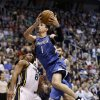 Minnesota Timberwolves point guard Alexey Shved (1) goes to the basket as Utah Jazz point guard Randy Foye (8) defends in the first quarter during an NBA basketball game on Wednesday, Jan. 2, 2013, in Salt Lake City. (AP Photo/Rick Bowmer)