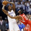 Oklahoma City\'s Serge Ibaka (9) keeps the ball away from Houston\'s James Harden (13) during Game 2 in the first round of the NBA playoffs between the Oklahoma City Thunder and the Houston Rockets at Chesapeake Energy Arena in Oklahoma City, Wednesday, April 24, 2013. Photo by Nate Billings, The Oklahoman