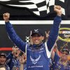 Photo - Aric Almirola celebrates in Victory Lane after winning the NASCAR Sprint Cup Series auto race at Daytona International Speedway in Daytona Beach, Fla., Sunday, July 6, 2014. (AP Photo/John Raoux)