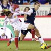 China\'s Wang Lisi and United States\' Alex Morgan (13) go after the ball during the first half of an exhibition soccer match, Wednesday, Dec. 12, 2012, in Houston. (AP Photo/David J. Phillip)