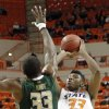 Oklahoma State \'s Marcus Smart (33) shoots the ball over South Florida Bulls\' Kore White (33) during the college basketball game between Oklahoma State University (OSU) and the University of South Florida (USF) on Wednesday , Dec. 5, 2012, in Stillwater, Okla. Photo by Chris Landsberger, The Oklahoman