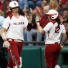 OU\'s Keilani Ricketts (10) is greeted by Callie Parsons after Ricketts scored in the 1st inning during an NCAA softball game between OU and Marist in the Oklahoma Regional in Norman, Okla., Friday, May 17, 2013. Oklahoma won 17-0 in 5 innings. Photo by Nate Billings, The Oklahoman