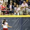 OU\'s Destinee Martinez (00) watches a fan try to catch a three-run home run by Tennessee\'s Madison Shipman (44) as it leaves the field in the eleventh inning during Game 1 of the Women\'s College World Series NCAA softball championship series between Oklahoma and Tennessee at ASA Hall of Fame Stadium in Oklahoma City, Monday, June 3, 2013. OU won 5-3 in 12 innings. Photo by Nate Billings, The Oklahoman