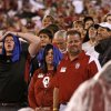 Photo - STORM DELAY: Fans look toward the sky during a weather delay before the college football game between the University of Oklahoma Sooners (OU) and Texas Tech at Gaylord Family-Oklahoma Memorial Stadium in Norman, Kansas, Saturday, Oct. 22, 2011. Photo by Bryan Terry, The Oklahoman  ORG XMIT: KOD