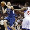 Minnesota Timberwolves\' Luke Ridnour (13) shoots against Philadelphia 76ers\' Lavoy Allen in the first half of an NBA basketball game, Tuesday, Dec. 4, 2012, in Philadelphia. (AP Photo/Matt Slocum)