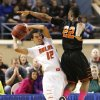 Douglass Trevon Threatt defends Roland\'s Seth Youngblood during the 4a boys championship game where the Douglass high school Trojans defeated the Roland Rangers 82-80 at the State Fair Arena on Saturday, March 9, 2013 in Oklahoma City, Okla. Photo by Steve Sisney, The Oklahoman