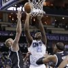 Photo - Charlotte Bobcats' Al Jefferson (25) shoots over Brooklyn Nets' Mason Plumlee (1) during the first half of an NBA basketball game in Charlotte, N.C., Wednesday, March 26, 2014. (AP Photo/Chuck Burton)