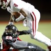 Owasso\'s Keon Hatcher is knocked off his feet by Westmoore\'s Archie Ocloolee during their playoff game at Moore High School in Moore, Oklahoma, on Friday Nov. 19, 2010. Photo by John Clanton, The Oklahoman