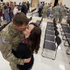 Spc Adam Nicely, Wagoner, is greeted by his girl friend Shae Bellis, 20, as members of the Oklahoma National Guard are welcomed by family and friends on their return from Afghanistan on Thursday, Jan. 12, 2012, in Norman, Okla. Photo by Steve Sisney, The Oklahoman