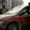 Photo - In this image made from pool video provided by APTN, Libyan men inspect the damages of a vehicle at the scene of a car bomb explosion in Benghazi, Libya, Monday, May 13, 2013. A car bomb exploded Monday near a hospital in the eastern Libyan city of Benghazi, killing many, officials said, in one of the biggest attacks since the end of the civil war that ousted former dictator Moammar Gadhafi. (AP Photo/APTN, Al Ahrar)