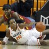 Oklahoma State\'s Toni Young (15) and Iowa State\'s Fallon Ellis (32) dive for a loose ball during the women\'s college basketball game between Oklahoma State and Iowa State at Gallagher-Iba Arena in Stillwater, Okla., Sunday,Jan. 20, 2013. OSU won 71-42. Photo by Sarah Phipps, The Oklahoman