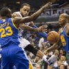Photo - Orlando Magic's Jameer Nelson (14) passes the ball under the basket against the Warriors Draymond Green(33) and Marreese Speights, right, during the first half of an NBA basketball game in Orlando, Fla., Tuesday, Dec. 31, 2013. (AP Photo/Willie J. Allen Jr.)