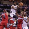 Charlotte Bobcats\' Chris Douglas-Roberts (55) drives past Washington Wizards\' Andre Miller (24) and Drew Gooden (90) during the first half of an NBA basketball game in Charlotte, N.C., Monday, March 31, 2014. (AP Photo/Chuck Burton)