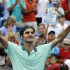 Photo - Roger Federer, from Switzerland, celebrates after defeating David Ferrer, from Spain, 6-3, 1-6, 6-2, in a final match at the Western and Southern Open tennis tournament, Sunday, Aug. 17, 2014, in Mason, Ohio. (AP Photo/Al Behrman)