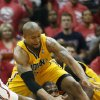 Photo - Atlanta Hawks forward Paul Millsap, bottom, and Indiana Pacers forward David West, top, battle for a loose ball in the first half of Game 6 of a first-round NBA basketball playoff series in Atlanta, Thursday, May 1, 2014. (AP Photo/John Bazemore)