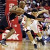 Miami Heat\'s Ray Allen (34) keeps Houston Rockets\' Carlos Delfino (10) away from the ball in the second half of an NBA basketball game, Monday, Nov. 12, 2012, in Houston. The Heat won 113-110. (AP Photo/Pat Sullivan)
