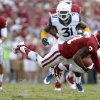 Oklahoma\'s Sterling Shepard (3) gets tripped up during a college football game between the University of Oklahoma Sooners (OU) and the West Virginia University Mountaineers at Gaylord Family-Oklahoma Memorial Stadium in Norman, Okla., on Saturday, Sept. 7, 2013. Photo by Bryan Terry, The Oklahoman
